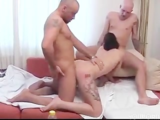 two bald men and one shaved woman