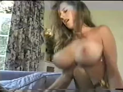 Beautiful brunette with big tits riding